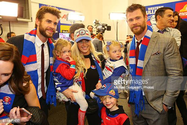 The partner of Liam Picken of the Bulldogs celebrates the win with actors Liam Hemsworth and his brother Chris Hemsworth during the 2016 AFL Grand...