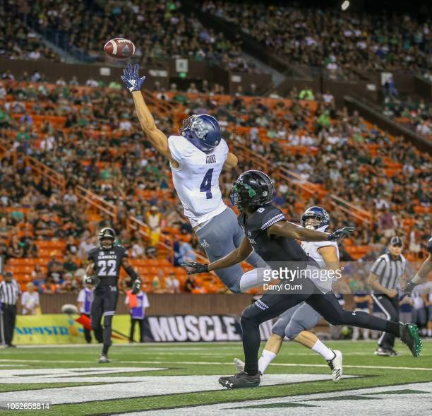 The pass sails over a jumping Elijah Cooks of the Nevada Wolf Pack during the second quarter of the game against the Hawaii Rainbow Warriors at Aloha...