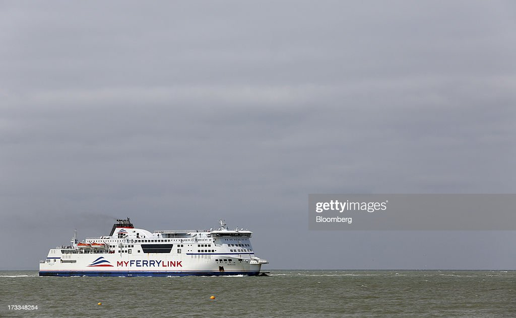 The passenger ferry 'Berloiz', operated by MyFerryLink, a unit of Groupe Eurotunnel SA, sails towards the Port of Calais in Calais, France, on Thursday, July 11, 2013. Eurotunnel was barred by the U.K. Competition Commission from operating a ferry service between France and Dover in the U.K. on concern it would give it too much dominance on the Channel traffic route. Photographer: Chris Ratcliffe/Bloomberg via Getty Images