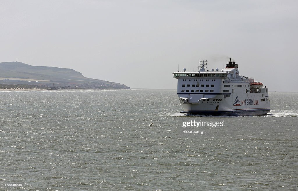 The passenger ferry 'Rodin', operated by MyFerryLink, a unit of Groupe Eurotunnel SA, sails towards the Port of Calais in Calais, France, on Thursday, July 11, 2013. Eurotunnel was barred by the U.K. Competition Commission from operating a ferry service between France and Dover in the U.K. on concern it would give it too much dominance on the Channel traffic route. Photographer: Chris Ratcliffe/Bloomberg via Getty Images