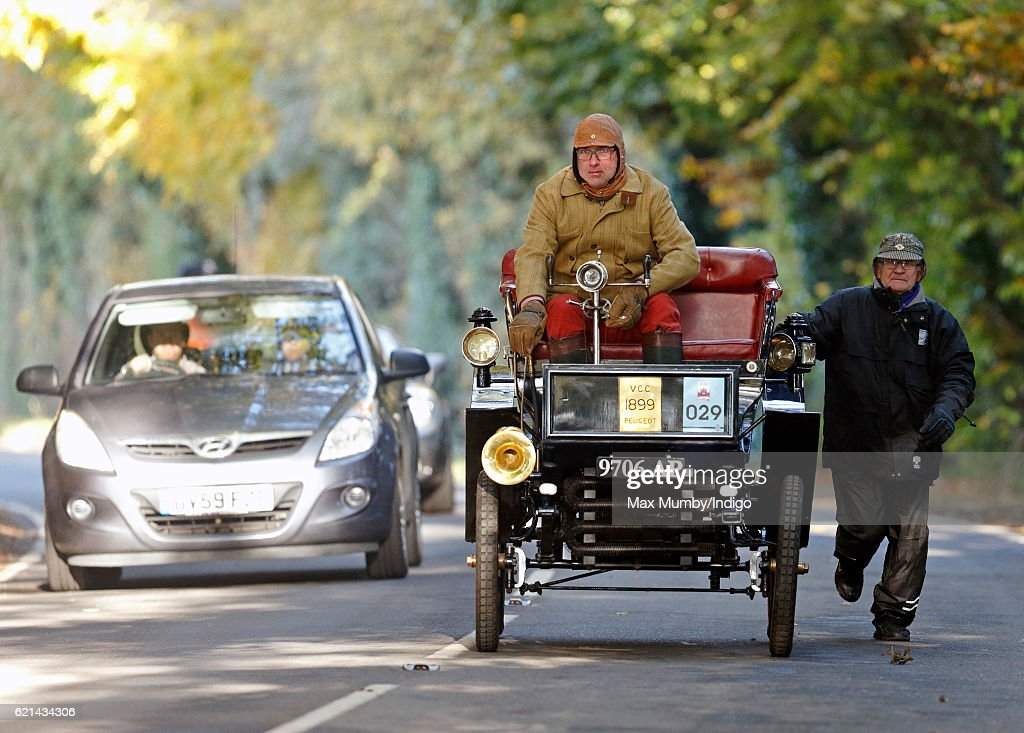 The passenger of an 1899 Peugeot has to run alongside the car as it travels uphill during the 120th London to Brighton Veteran Car Run on November 6, 2016 in Staplefield, England. Over 400 pre-1905 manufactured vehicles take part in the annual run from London to Brighton to commemorate the Emancipation Run of November 1896 which celebrated the raising of the speed limit from 4mph to 14 mph.