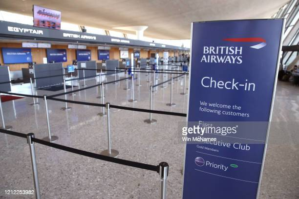 The passenger queue at the British Airways counter at Dulles International Airport sits empty March 13, 2020 in Dulles, Virginia. U.S. President...
