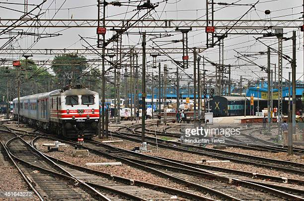 The passenger train sets off during the trial run of a 'semi-bullet train' between New Delhi and Agra from New Delhi railway station on June 3, 2014...