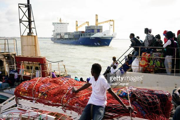 The passengers on one of the main transport arteries to cross The Gambia River is the ferry between Banjul and Barra, The Gambia. There are several...
