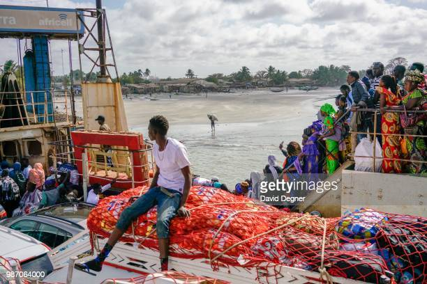 The passengers on one of the main transport arteries to cross The Gambia River is the ferry between Banjul and Barra The Gambia There are several...