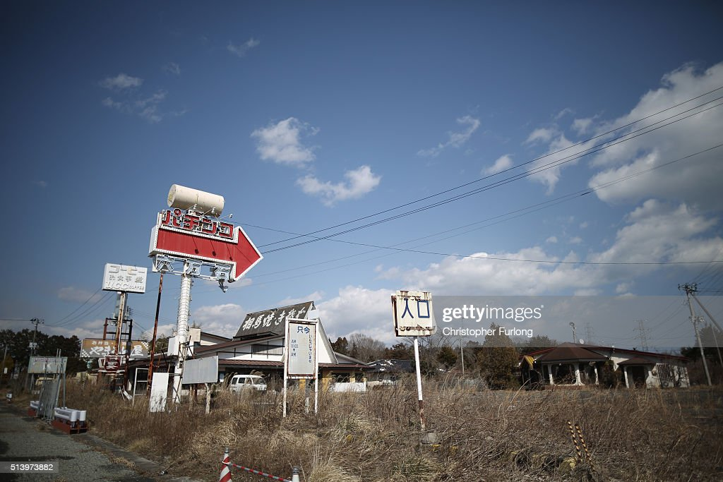 The passing of five years shows as vegetation and the elements begin to take their toll on homes and businesses inside the deserted exclusion zone close to the devastated Fukushima Daiichi Nuclear Power Plant on February 26, 2016 in Okuma, Japan. The area is now closed to residents due to radiation contamination from the Fukishima nuclear disaster. March 11, 2016 marks the fifth anniversary of the magnitude 9.0 earthquake and tsunami which claimed the lives of 15,894, and the subsequent damage to the reactors at TEPCO's Fukushima Daiichi Nuclear Power Plant causing the nuclear disaster which still forces 99,750 people to live as evacuees away from contaminated areas.