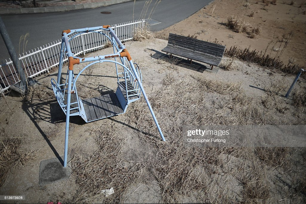 The passing of five years shows on a children's play area as vegetation and the elements begin to take their toll on homes and businesses inside the deserted exclusion zone close to the devastated Fukushima Daiichi Nuclear Power Plant on February 26, 2016 in Tomioka, Japan. The area is now closed to residents due to radiation contamination from the Fukishima nuclear disaster. March 11, 2016 marks the fifth anniversary of the magnitude 9.0 earthquake and tsunami which claimed the lives of 15,894, and the subsequent damage to the reactors at TEPCO's Fukushima Daiichi Nuclear Power Plant causing the nuclear disaster which still forces 99,750 people to live as evacuees away from contaminated areas.