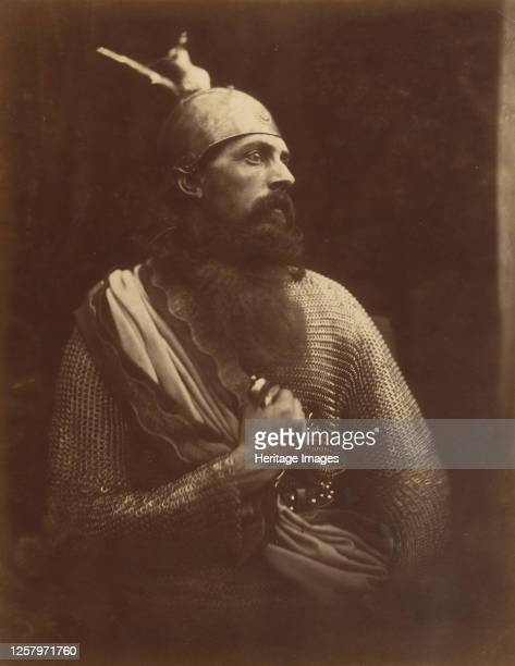 The Passing of King Arthur 1874 A melodramatic depiction of Arthurs death scene A bearded man in profile wearing chainmail and an armour helmet with...