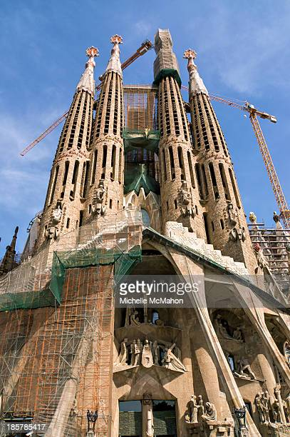 The Passion Facade of the Sagrada Família. This large Roman Catholic church in Barcelona, Spain was designed by Catalan architect Antoni Gaudí....