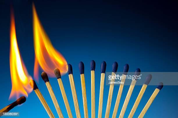 the passion of one ignites new ideas, social movements, change - match lighting equipment stock photos and pictures