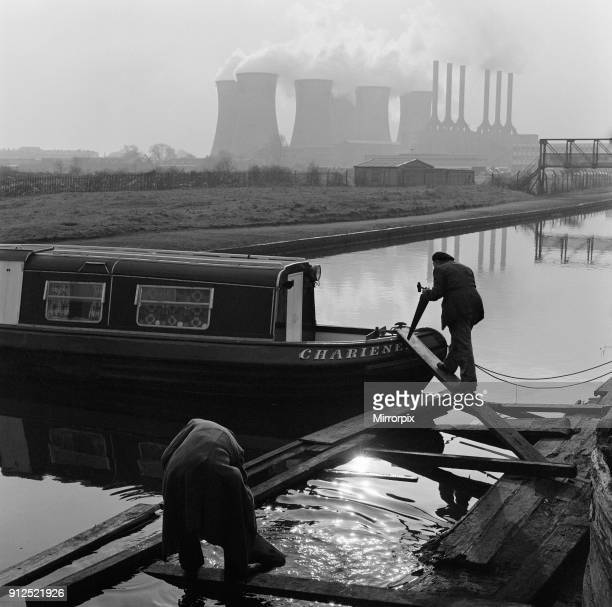 The past and future meet in this picture at the boatyard in Walsall West Midlands As boatbuilder's are pictured at work on a longboat in the...