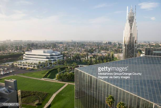The Pastoral Center and Christ Cathedral Academy, left, and the Crystal Cathedral, right, seen from the Chapel in the Sky located on the top floor of...