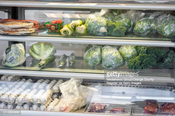 The pastry case at Great Dane Baking Company is now filled with fresh vegetables, meat and eggs in Los Alamitos on Thursday, March 19, 2020. When the...