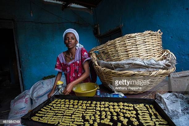 The pastry chef prepares the cookies to bake in the old city of harar