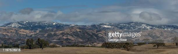 The pastures turn a golden autumn color and a fresh dusting of snow is viewed along the nearby mountains on December 10 near Santa Ynez, California....