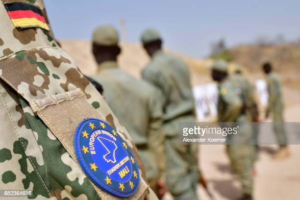 The patch of the Bundeswehr and the EUTM Mission are pictured during a shooting class at a training compound on March 10 2017 in Koulikoro Mali The...