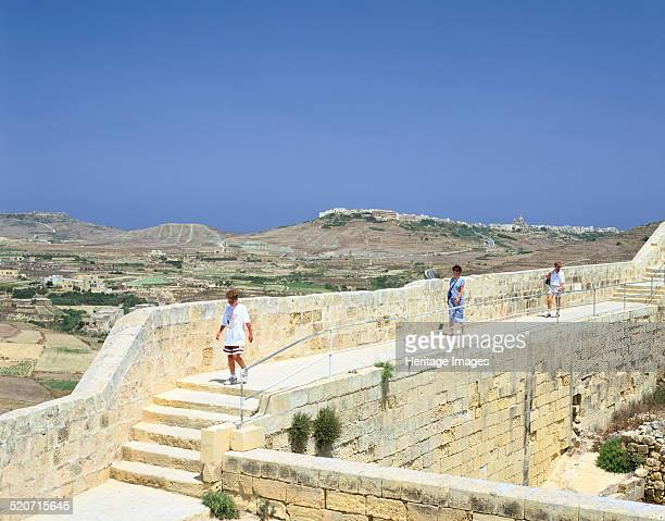 The path around the walls of the citadel Victoria Gozo Malta After the siege of Malta by the Ottomans in 1565 the Knights of St John extended and...