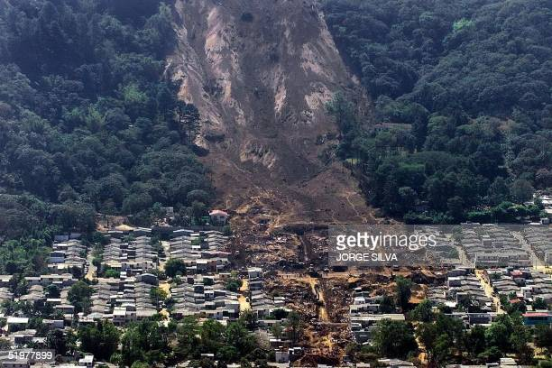 The path of a massive landslide triggered by the 13 January earthquake shows the devastation 16 January 2001 at the suburb of Santa Tecla in San...