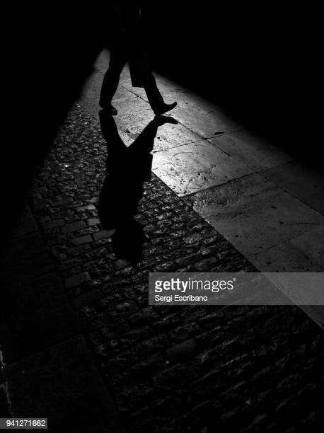 the path of your shadow - spion stockfoto's en -beelden