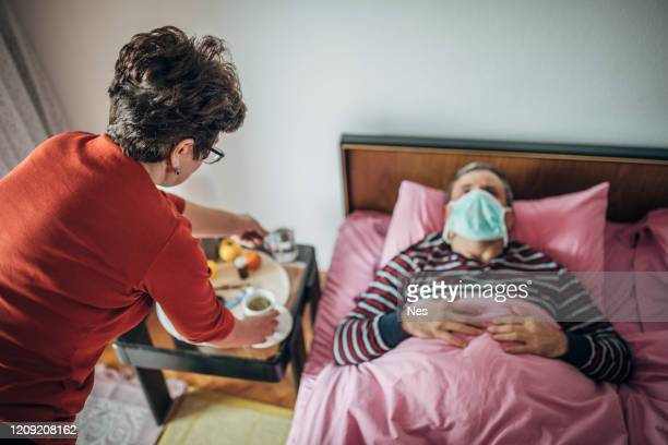 the patient uses a mobile phone - illness stock pictures, royalty-free photos & images