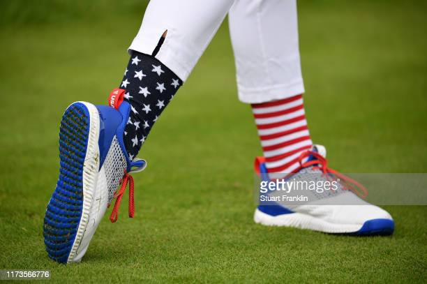 The patriotic socks and footwear of Jessica Korda of Team USA during a practice round prior to the start of The Solheim Cup at Gleneagles on...