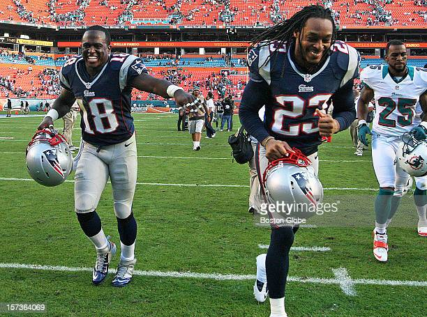 The Patriots' Matthew Slater left and Marquice Cole right share a laugh as they leave the field following New England's AFC East title clinching 2316...