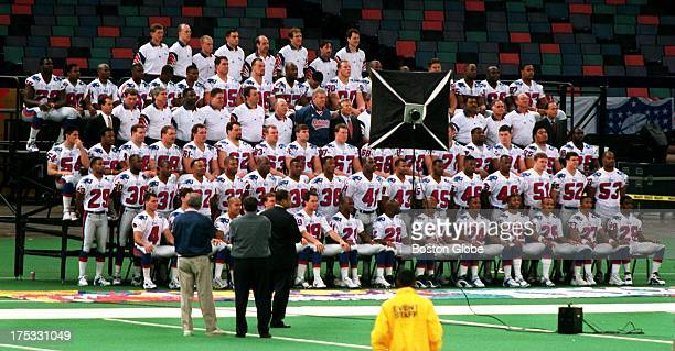 The Patriots pose for their official team photo with Bill Parcells and Bob Kraft together in the middle prior to the start of Media Day Photographer...