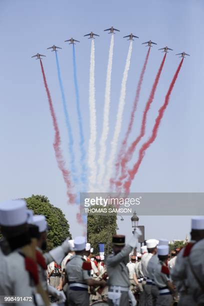 The Patrouille de France Alpha Jet aircrafts fly over the Arc de Triomphe at the start of the annual Bastille Day military parade on the...
