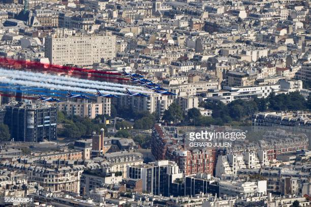 The Patrouille de France Alpha Jet aircrafts perform at the start of the annual Bastille Day military parade over the ChampsElysees avenue in Paris...