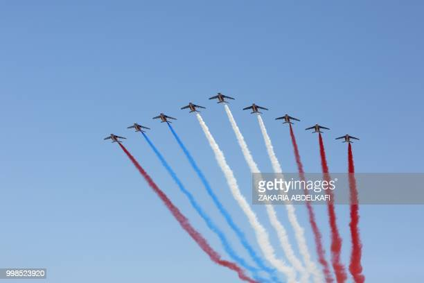 The Patrouille de France Alpha Jet perform at the start of the annual Bastille Day military parade over the ChampsElysees avenue in Paris on July 14...