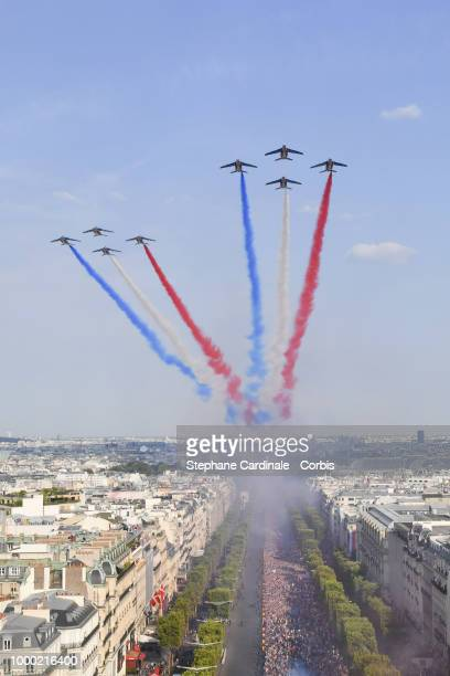 The 'Patrouille De France' is seen as the Bus of France's World Cup Winning Team Parade Down The Champs Elysees on July 16 2018 at the Champs Elysees...