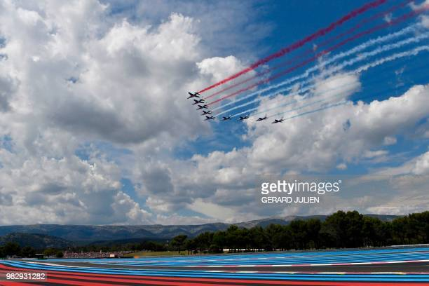 The Patrouille de France performs ahead of the Formula One Grand Prix de France at the Circuit Paul Ricard in Le Castellet southern France on June 24...