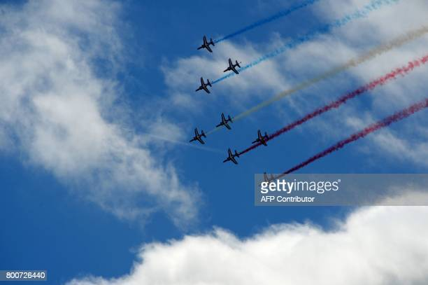 The Patrouille de France precision aerobatic demonstration team performs a flight display on the last day of the International Paris Air Show on June...