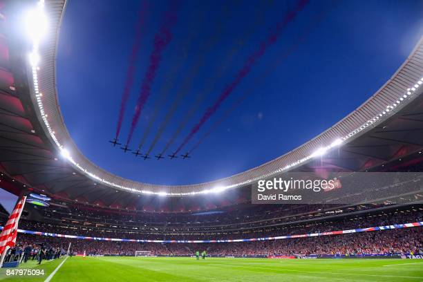 The Patrulla Aguila performs prior to the La Liga match between Atletico Madrid and Malaga at Wanda Metropolitano stadium on September 16, 2017 in...