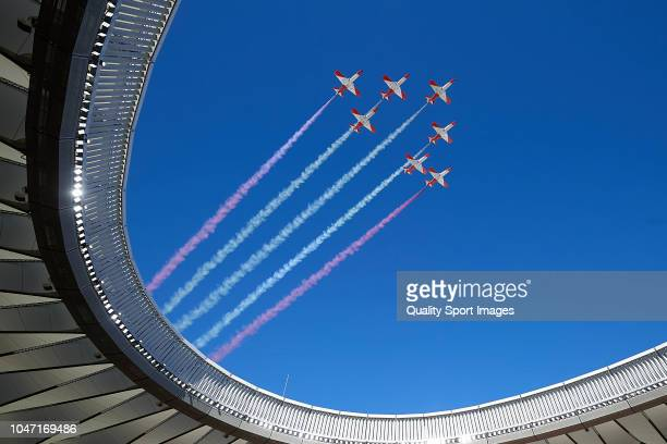 The Patrulla Aguila performs prior to the La Liga match between Club Atletico de Madrid and Real Betis Balompie at Wanda Metropolitano on October 7...