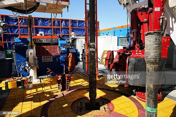 The Patterson 298 natural gas fueled drilling rig drills on land in the Permian Basin that is owned by Apache Corporation on February 5 2015 in...