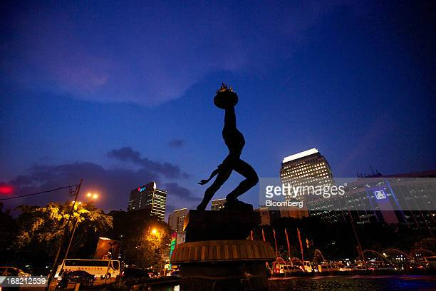 The Patung Pemuda Youth Monument stands amid congested traffic at night in central Jakarta Indonesia on Monday May 6 2013 The Philippines beat...