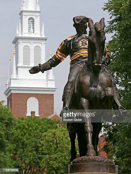 The Paul Revere statue in the North End With the Boston Bruins in the Stanley Cup Finals statues around Boston are dressed up in Bruins gear that...