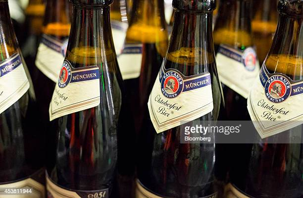 The Paulaner logo sits on Oktoberfest Bier labels as filled bottles move along the production line at the Paulaner Brauerei GmbH brewery in Munich...