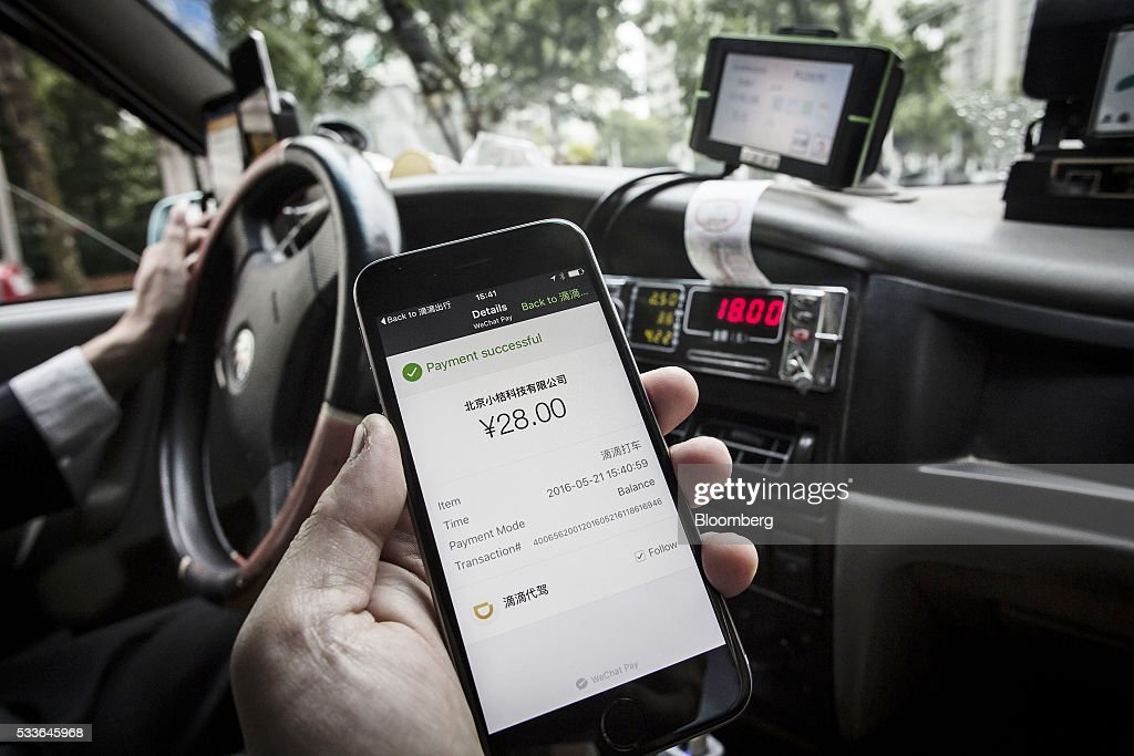The payment confirmation page is displayed on the Didi Chuxing application in this arranged photograph taken in Shanghai, China, on Sunday, May 22, 2016. Philippe Laffont's Coatue Management LLC, which manages more than $7 billion, has backed China's biggest ride-hailing app Didi Chuxing as it competes with Uber Technologies Inc. Photographer: Qilai Shen/Bloomberg via Getty Images