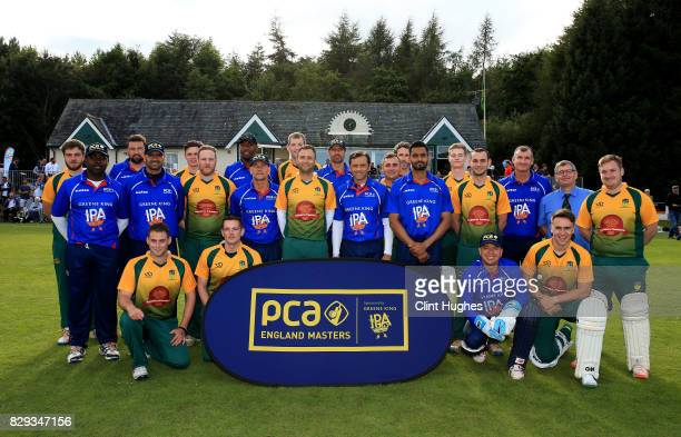 The PCA England Masters and Cockermouth Cricket Club teams pose for a photo during the PCA England Masters Day at Cockermouth Cricket Club on August...
