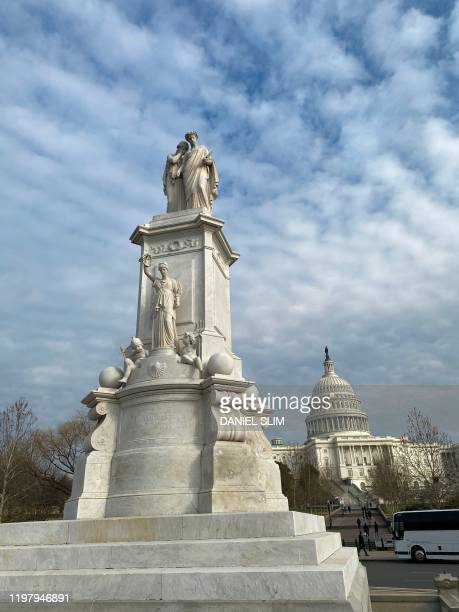 The Peace Monument also known as the Naval Monument or Civil War Sailors Monument is pictured with the US Capitol building in the background on...