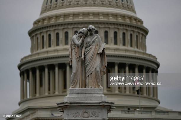 The Peace Monument memorial is seen in front of the US Capitol on January 6 in Washington, DC. - Donald Trump's supporters stormed a session of...