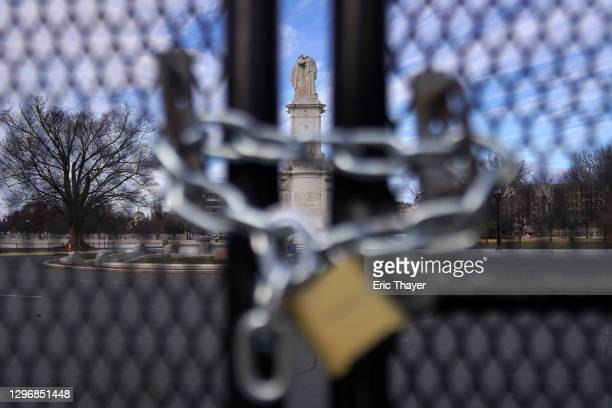 The Peace Monument on U.S. Capitol grounds is seen behind a fence on January 17, 2021 in Washington, DC. After last week's riots at the U.S. Capitol...
