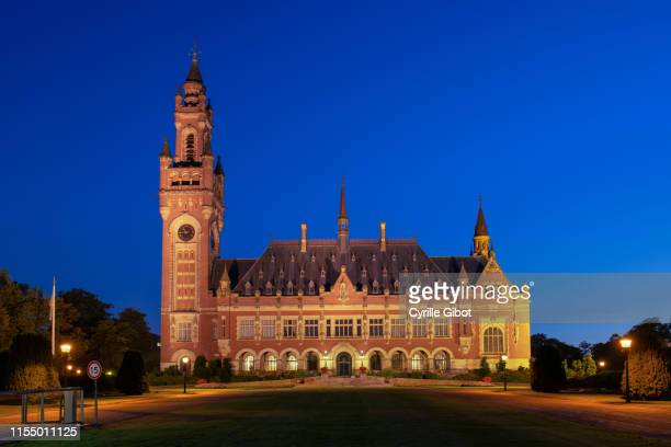 the peace palace in the hague, the netherlands - international court of justice stock pictures, royalty-free photos & images