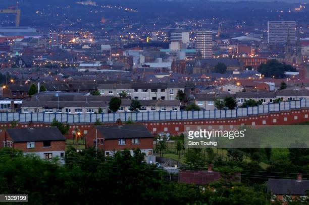 The Peace Wall divides Republican and Loyalist neighborhoods in West Belfast on the evening of Ulster First Minister David Trimble''s resignation...