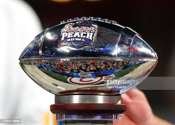 The Peach Bowl trophy on the stand after the Chick-fil-A Peach Bowl against the Cincinnati Bearcats at Mercedes-Benz Stadium on January 1, 2021 in...
