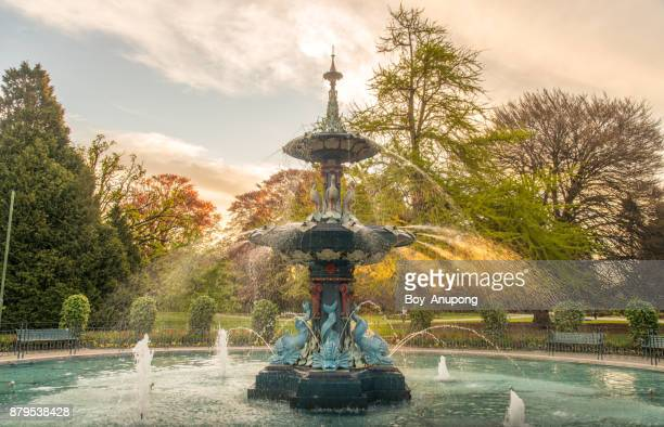 The Peacock Fountain during the sunset in Christchurch Botanic Gardens, New Zealand.