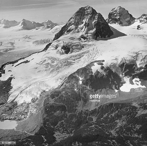 The peak of Mount Jacobsen in British Columbia's Coast Mountains rises above thick snowcoated glaciers that cover nearly the entire mountain Mount...