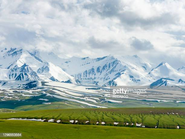 The peaks of Pik Kurumdy at the border triangle of Kyrgyzstan. China and Tadjikistan. The Alaj valley in the Pamir Mountains. Asia. Central Asia....